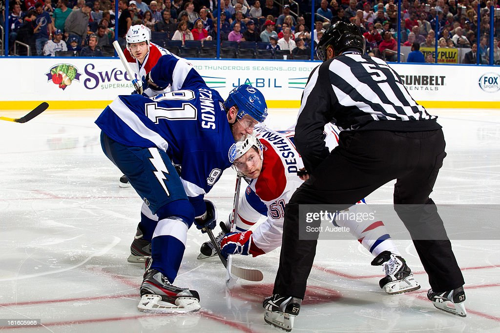 <a gi-track='captionPersonalityLinkClicked' href=/galleries/search?phrase=Steven+Stamkos&family=editorial&specificpeople=4047623 ng-click='$event.stopPropagation()'>Steven Stamkos</a> #91 of the Tampa Bay Lightning faces off with <a gi-track='captionPersonalityLinkClicked' href=/galleries/search?phrase=David+Desharnais&family=editorial&specificpeople=4084305 ng-click='$event.stopPropagation()'>David Desharnais</a> #51 of the Montreal Canadiens during the second period of the game at the Tampa Bay Times Forum on February 12, 2013 in Tampa, Florida.