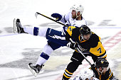 Steven Stamkos of the Tampa Bay Lightning falls to the ice after colliding with Matt Cullen of the Pittsburgh Penguins during the third period in...