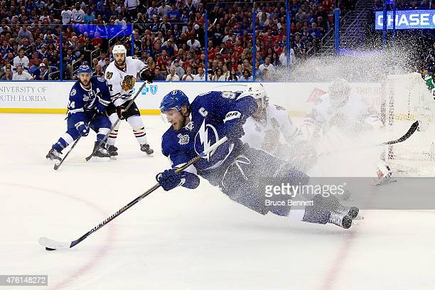Steven Stamkos of the Tampa Bay Lightning falls to the ice against the Chicago Blackhawks during the second period in Game Two of the 2015 NHL...