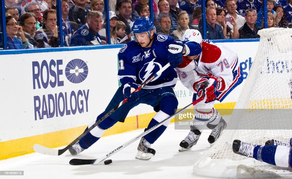 <a gi-track='captionPersonalityLinkClicked' href=/galleries/search?phrase=Steven+Stamkos&family=editorial&specificpeople=4047623 ng-click='$event.stopPropagation()'>Steven Stamkos</a> #91 of the Tampa Bay Lightning fights for control of the puck with <a gi-track='captionPersonalityLinkClicked' href=/galleries/search?phrase=Andrei+Markov&family=editorial&specificpeople=204528 ng-click='$event.stopPropagation()'>Andrei Markov</a> #79 of the Montreal Canadiens during the first period of the game at the Tampa Bay Times Forum on February 12, 2013 in Tampa, Florida.