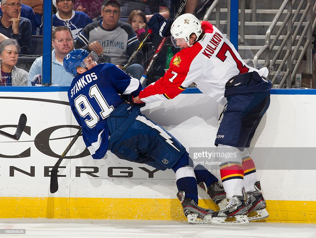 <a gi-track='captionPersonalityLinkClicked' href=/galleries/search?phrase=Steven+Stamkos&family=editorial&specificpeople=4047623 ng-click='$event.stopPropagation()'>Steven Stamkos</a> #91 of the Tampa Bay Lightning gets upended by Dmitry Kulikov #7 of the Florida Panthers during the third period of the Tampa Bay Lightning against the Florida Panthers at the Tampa Bay Times Forum on January 29, 2013 in Tampa, Florida.