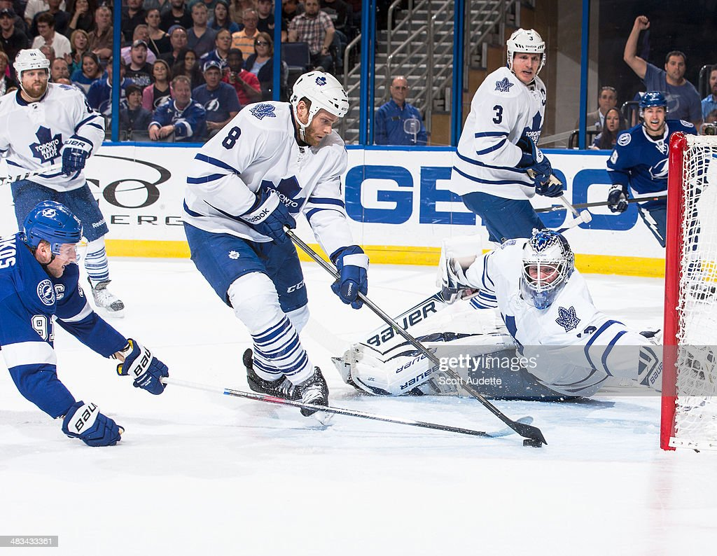 Steven Stamkos #91 of the Tampa Bay Lightning has his shot blocked by Tim Gleason #8 of the Toronto Maple Leafs while goalie James Reimer #34 attempts to make a save during the first period at the Tampa Bay Times Forum on April 8, 2014 in Tampa, Florida.