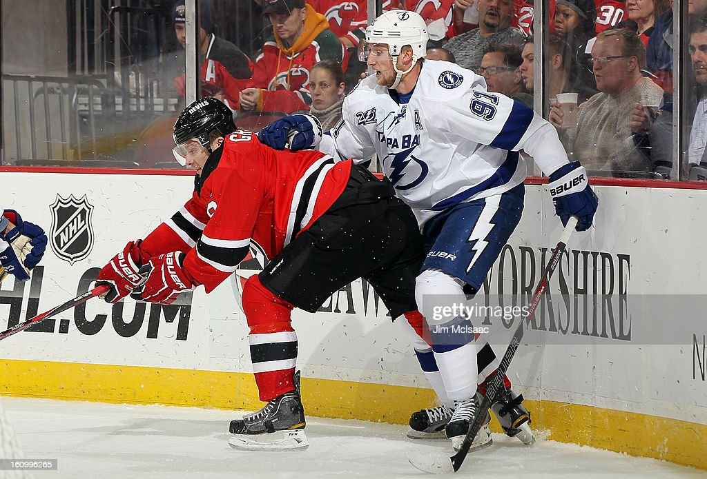 Steven Stamkos #91 of the Tampa Bay Lightning in action against Andy Greene #6 of the New Jersey Devils at the Prudential Center on February 7, 2013 in Newark, New Jersey. The Devils defeated the Lightning 4-2.