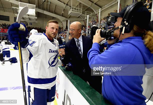 Steven Stamkos of the Tampa Bay Lightning is interviewed by broadcaster Pierre McGuire before the NHL Kraft Hockeyville USA preseason game against...