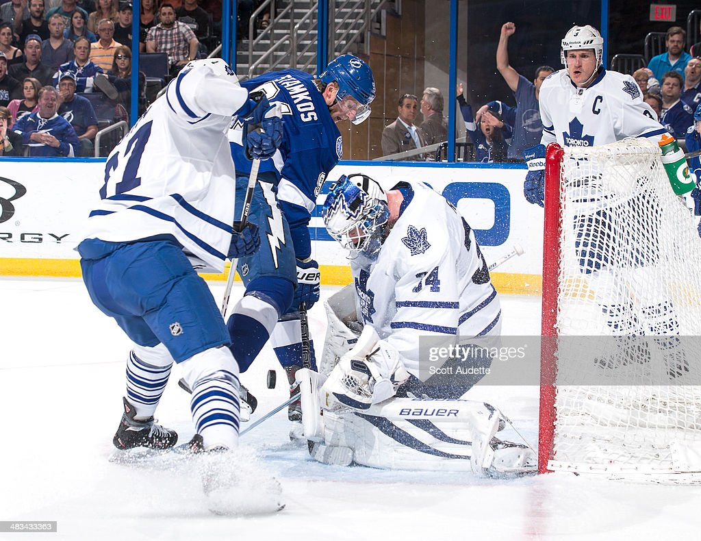 Steven Stamkos #91 of the Tampa Bay Lightning looks for a rebound against goalie James Reimer #34 and Carter Ashton #37 of the Toronto Maple Leafs during the first period at the Tampa Bay Times Forum on April 8, 2014 in Tampa, Florida.