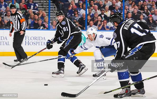 Steven Stamkos of the Tampa Bay Lightning passes the puck to teammate Alex Killorn and under the stick of Eric Brewer of the Toronto Maple Leafs...