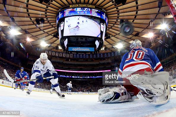 Steven Stamkos of the Tampa Bay Lightning scores a goal against Henrik Lundqvist of the New York Rangers during the second period in Game Five of the...