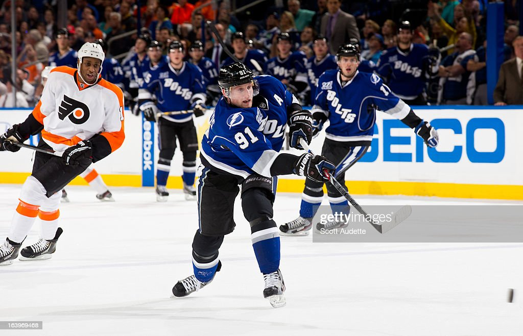 <a gi-track='captionPersonalityLinkClicked' href=/galleries/search?phrase=Steven+Stamkos&family=editorial&specificpeople=4047623 ng-click='$event.stopPropagation()'>Steven Stamkos</a> #91 of the Tampa Bay Lightning shoots and scores his 200th career goal during the third period of the game against the Philadelphia Flyers at the Tampa Bay Times Forum on March 18, 2013 in Tampa, Florida.