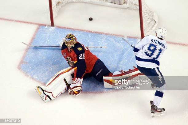 Steven Stamkos of the Tampa Bay Lightning shoots and scores in a shoot out against Goaltender Jacob Markstrom of the Florida Panthers at the BBT...