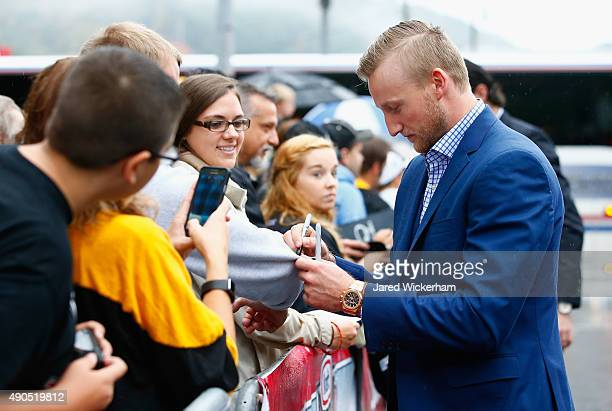Steven Stamkos of the Tampa Bay Lightning signs autographs as he arrives for practice for the NHL Kraft Hockeyville USA preseason game against the...