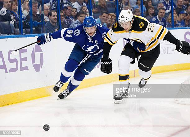 Steven Stamkos of the Tampa Bay Lightning skates against Brandon Carlo of the Boston Bruins during the first period at Amalie Arena on November 3...