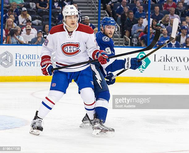 Steven Stamkos of the Tampa Bay Lightning skates against Nathan Beaulieu of the Montreal Canadiens during the first period at the Amalie Arena on...