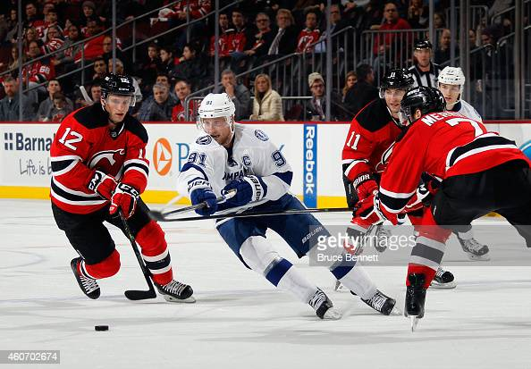 Steven Stamkos of the Tampa Bay Lightning skates against the New Jersey Devils at the Prudential Center on December 19 2014 in Newark New Jersey The...