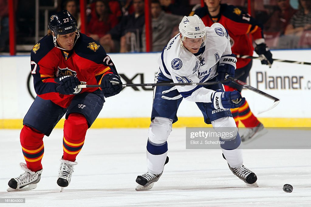 Steven Stamkos #91 of the Tampa Bay Lightning skates with the puck against Alex Kovalev #27 of the Florida Panthers at the BB&T Center on February 16, 2013 in Sunrise, Florida.