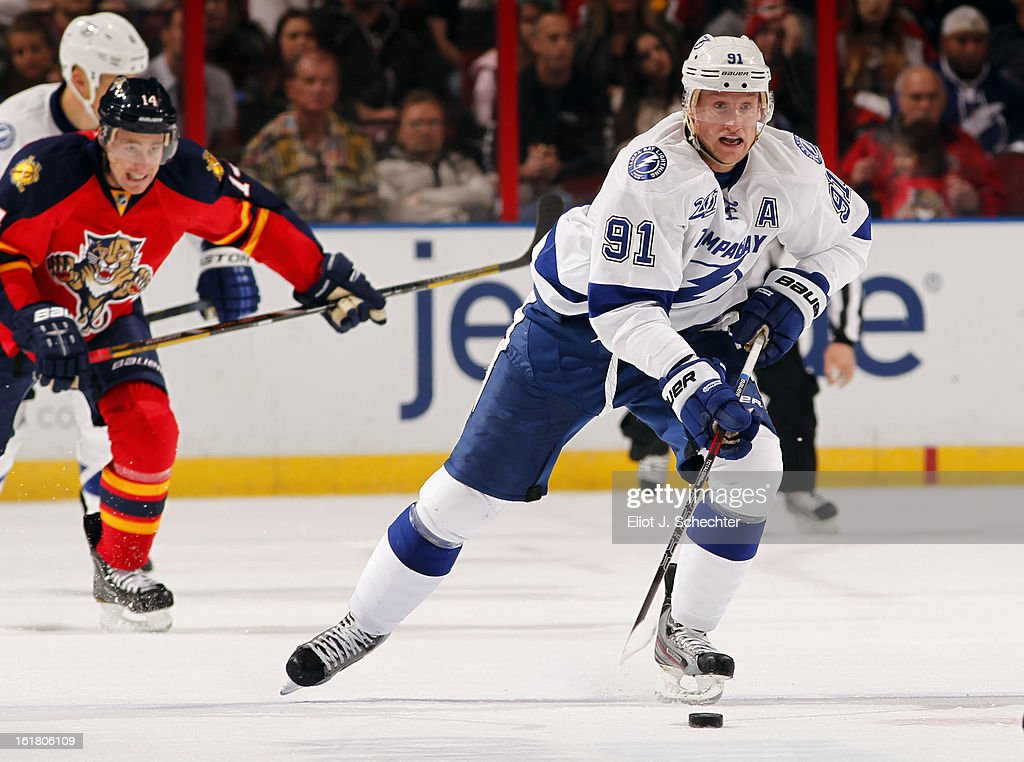 Steven Stamkos #91 of the Tampa Bay Lightning skates with the puck against the Florida Panthers at the BB&T Center on February 16, 2013 in Sunrise, Florida.