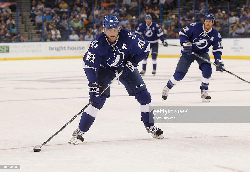 <a gi-track='captionPersonalityLinkClicked' href=/galleries/search?phrase=Steven+Stamkos&family=editorial&specificpeople=4047623 ng-click='$event.stopPropagation()'>Steven Stamkos</a> #91 of the Tampa Bay Lightning skates with the puck against the Nashville Predators at Tampa Bay Times Forum on September 19, 2013 in Tampa, Florida.