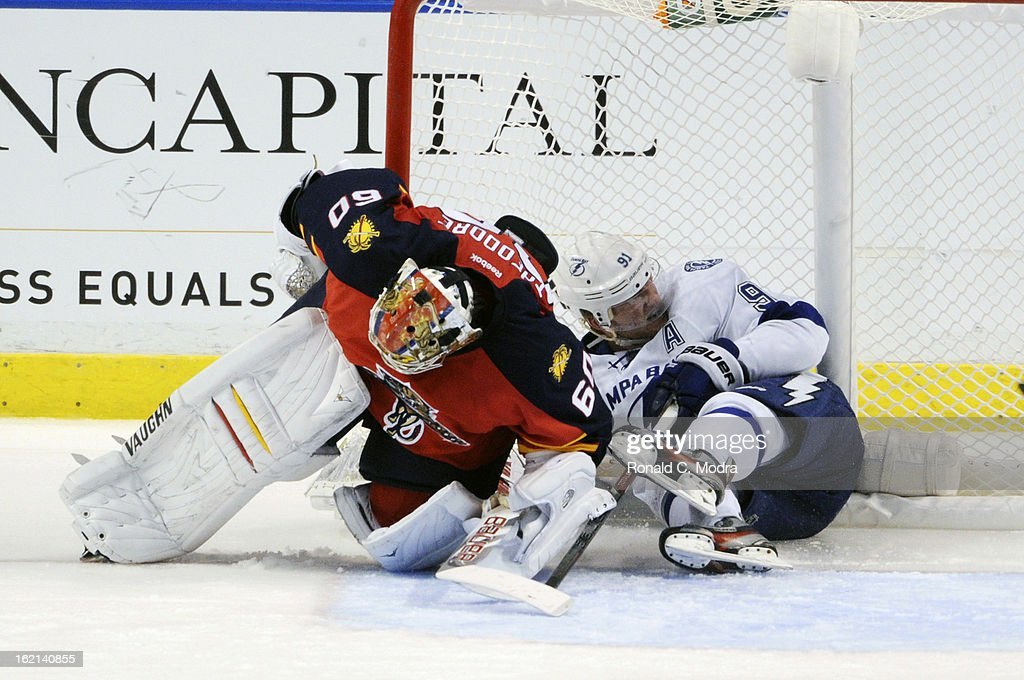 Steven Stamkos #91 of the Tampa Bay Lightning tangles with goaltender Jose Theodore #60 of the Florida Panthers during a NHL game at the BB&T Center on February 16, 2013 in Sunrise, Florida.