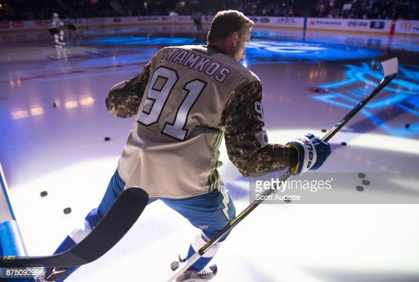 Steven Stamkos the Tampa Bay Lightning wears a Military Appreciation Night jersey for pregame warm ups against the Dallas Stars at Amalie Arena on...