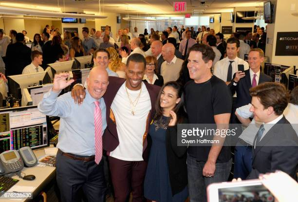 Steven Starker Victor Cruz Laurie Hernandez and Mark Cuban attend BTIG's 15th Commissions for Charity Day at BTIG on May 2 2017 in New York City