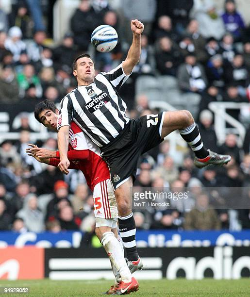 Steven Taylor heads the ball under a challenge from Rhys Williams during the CocaCola championship match between Newcastle United and Miiddlesbrough...