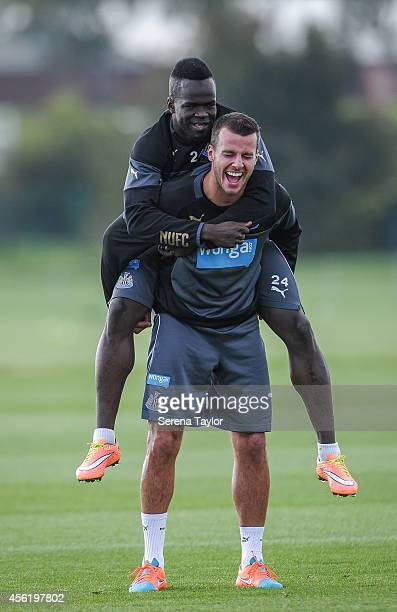 Steven Taylor laughs as Cheick Tiote jumps on his back during a training session at The Newcastle United Training Centre on September 27 in Newcastle...