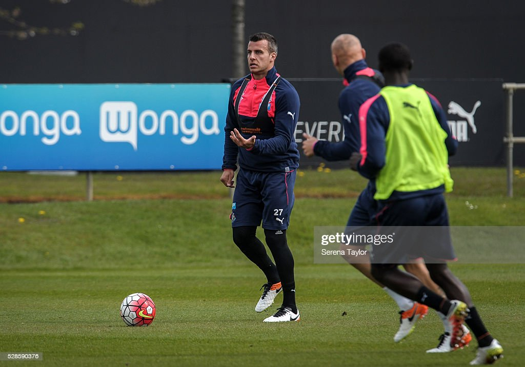 Steven Taylor (L) looks to pass the ball during the Newcastle United Training session at The Newcastle United Training Centre on May 6, 2016, in Newcastle upon Tyne, England.