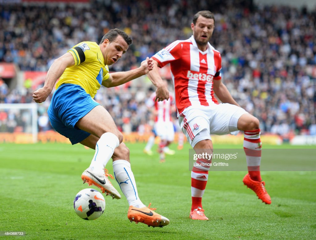 Steven Taylor of Newcastle United battles with Eric Pieters of Stoke City during the Barclays Premier League match between Stoke City and Newcastle United at Britannia Stadium on April 12, 2014 in Stoke on Trent, England.