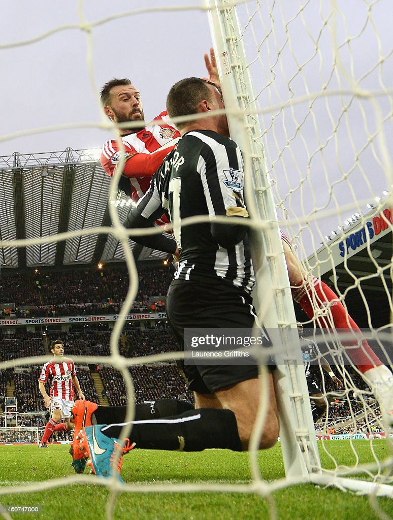 Steven Taylor of Newcastle United collides with the post during the Barclays Premier League match between Newcastle United and Sunderland at St James' Park on December 21, 2014 in Newcastle upon Tyne, England.