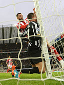 Steven Taylor of Newcastle United collides with the post during the Barclays Premier League match between Newcastle United and Sunderland at St...