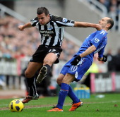 Steven Taylor of Newcastle United hits out at Martin Petrov of Bolton Wanderers during the Barclays Premier League match between Newcastle United and...