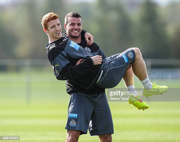 Steven Taylor smiles whilst holding Jack Colback during a training session at The Newcastle United Training Centre on September 27 in Newcastle upon...