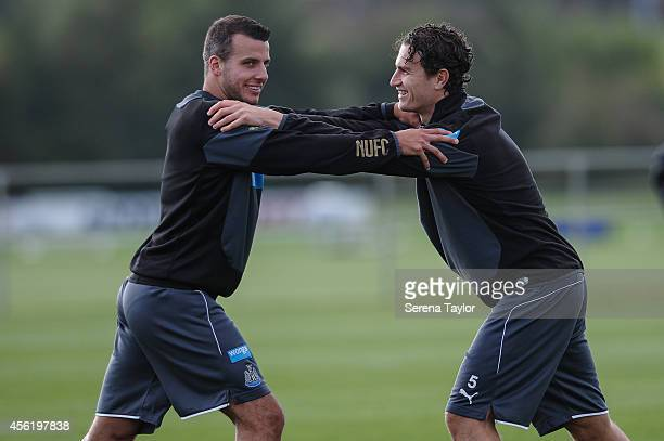 Steven Taylor smiles with Daryl Janmaat during a training session at The Newcastle United Training Centre on September 27 in Newcastle upon Tyne...