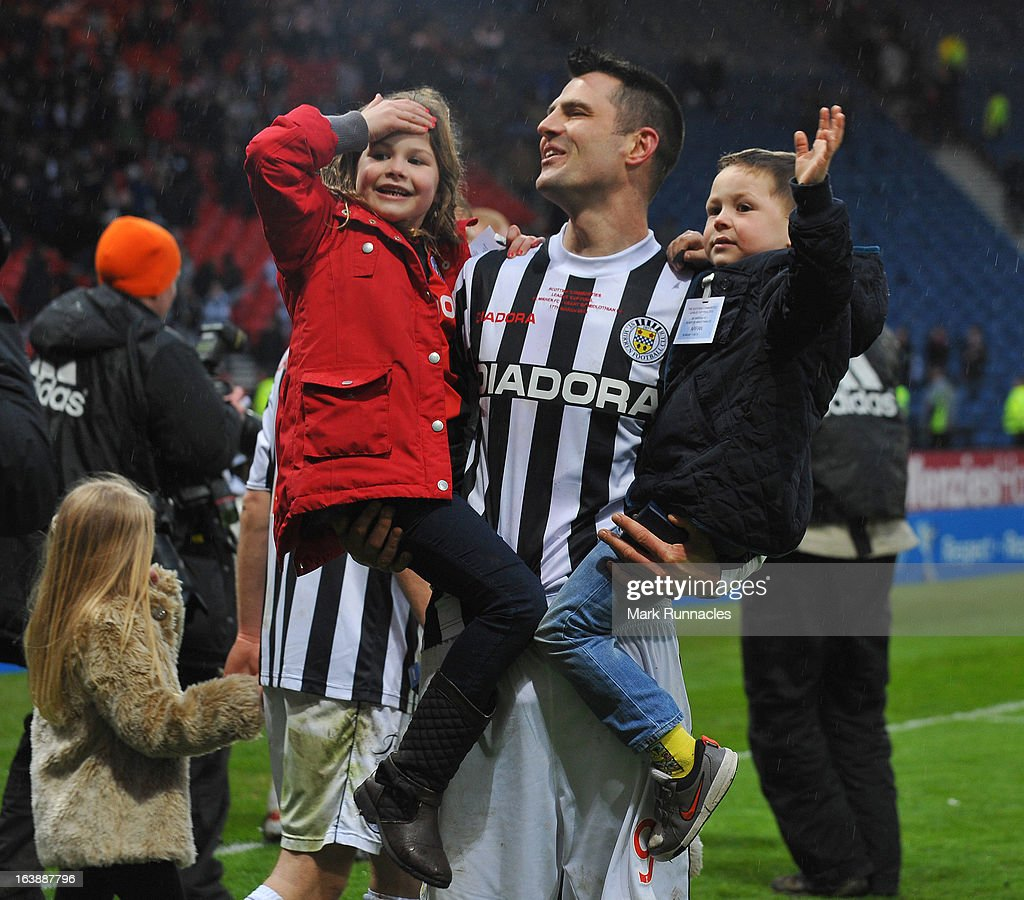 Steven Thomson of St Mirren celebrates St Mirrens famous victory with his children during the Scottish Communities League Cup Final between St Mirren and Hearts at Hampden Park on March 17, 2013 in Glasgow, Scotland.