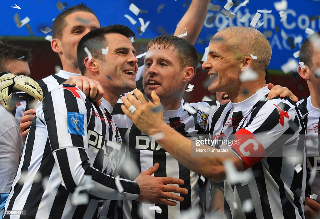 Steven Thomson of St Mirren celebrates with team-mates Jim Goodwin (R) and David Van Zanten (C) during the Scottish Communities League Cup Final between St Mirren and Hearts at Hampden Park on March 17, 2013 in Glasgow, Scotland.