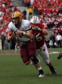 Steven Threet of the Arizona State Sun Devils tries to break away from Patrick Butrym of the Wisconsin Badgers at Camp Randall Stadium on September...