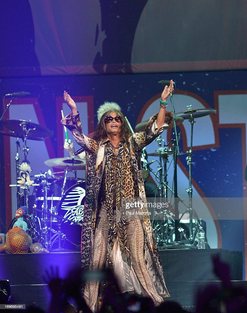 <a gi-track='captionPersonalityLinkClicked' href=/galleries/search?phrase=Steven+Tyler+-+Musician&family=editorial&specificpeople=202080 ng-click='$event.stopPropagation()'>Steven Tyler</a> and Aerosmith perform during the Boston Strong: An Evening Of Support And Celebration>> at TD Garden on May 30, 2013 in Boston, Massachusetts.