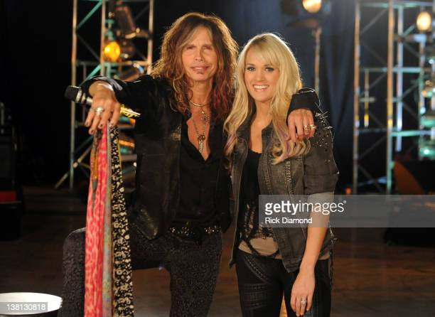 Steven Tyler and Carrie Underwood pose at the CMT Crossroads Live From 'Pepsi Super Bowl Fan Jam' rehearsals at Indiana State Fairgrounds Pepsi...