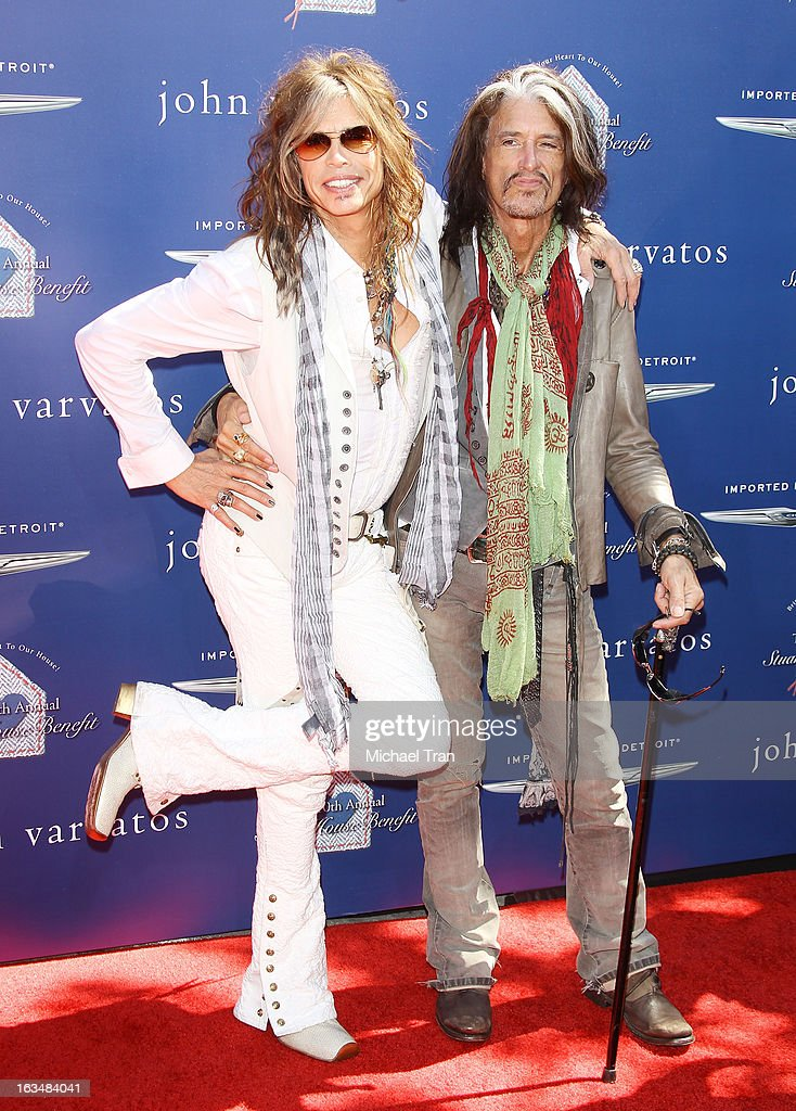 <a gi-track='captionPersonalityLinkClicked' href=/galleries/search?phrase=Steven+Tyler+-+Musician&family=editorial&specificpeople=202080 ng-click='$event.stopPropagation()'>Steven Tyler</a> (L) and <a gi-track='captionPersonalityLinkClicked' href=/galleries/search?phrase=Joe+Perry+-+Musician&family=editorial&specificpeople=13600677 ng-click='$event.stopPropagation()'>Joe Perry</a> arrive at The John Varvatos 10th Annual Stuart House Benefit held on March 10, 2013 in Los Angeles, California.