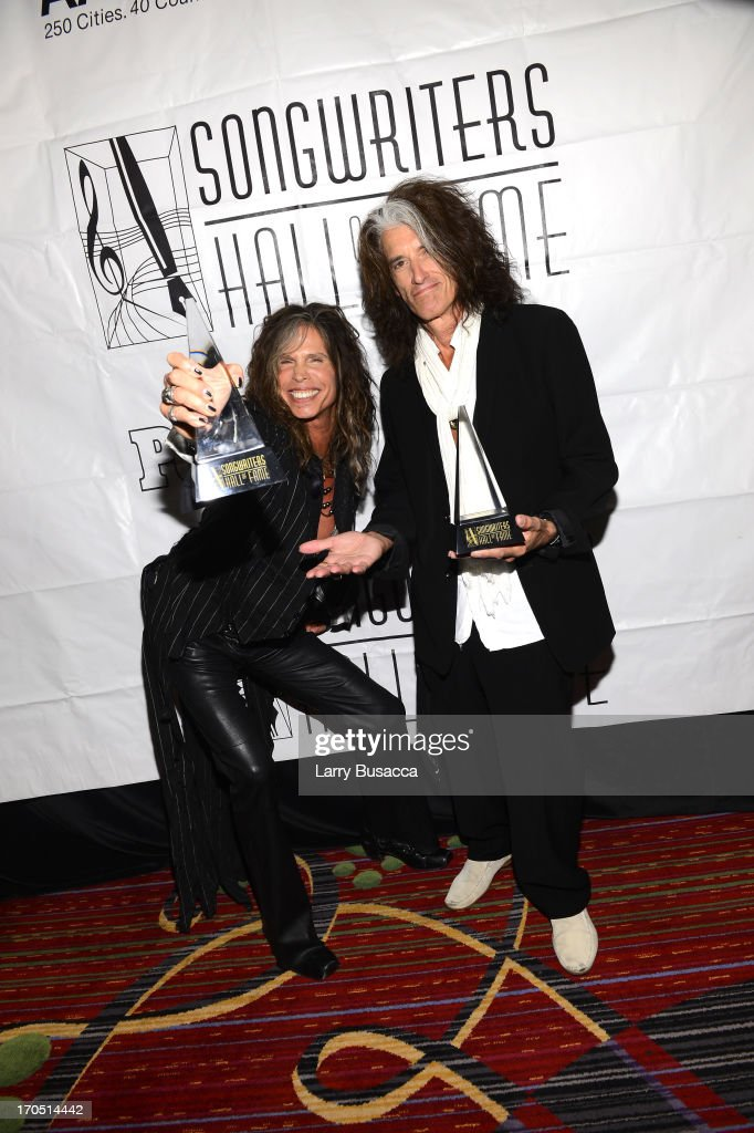 <a gi-track='captionPersonalityLinkClicked' href=/galleries/search?phrase=Steven+Tyler&family=editorial&specificpeople=202080 ng-click='$event.stopPropagation()'>Steven Tyler</a> and <a gi-track='captionPersonalityLinkClicked' href=/galleries/search?phrase=Joe+Perry+-+Musicista&family=editorial&specificpeople=13600677 ng-click='$event.stopPropagation()'>Joe Perry</a> of Aerosmith attend the Songwriters Hall of Fame 44th Annual Induction and Awards Dinner at the New York Marriott Marquis on June 13, 2013 in New York City.