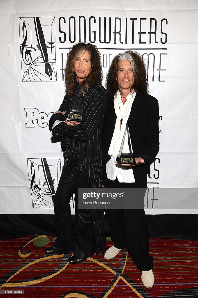 <a gi-track='captionPersonalityLinkClicked' href=/galleries/search?phrase=Steven+Tyler&family=editorial&specificpeople=202080 ng-click='$event.stopPropagation()'>Steven Tyler</a> and <a gi-track='captionPersonalityLinkClicked' href=/galleries/search?phrase=Joe+Perry+-+Muzikant&family=editorial&specificpeople=13600677 ng-click='$event.stopPropagation()'>Joe Perry</a> of Aerosmith attend the Songwriters Hall of Fame 44th Annual Induction and Awards Dinner at the New York Marriott Marquis on June 13, 2013 in New York City.