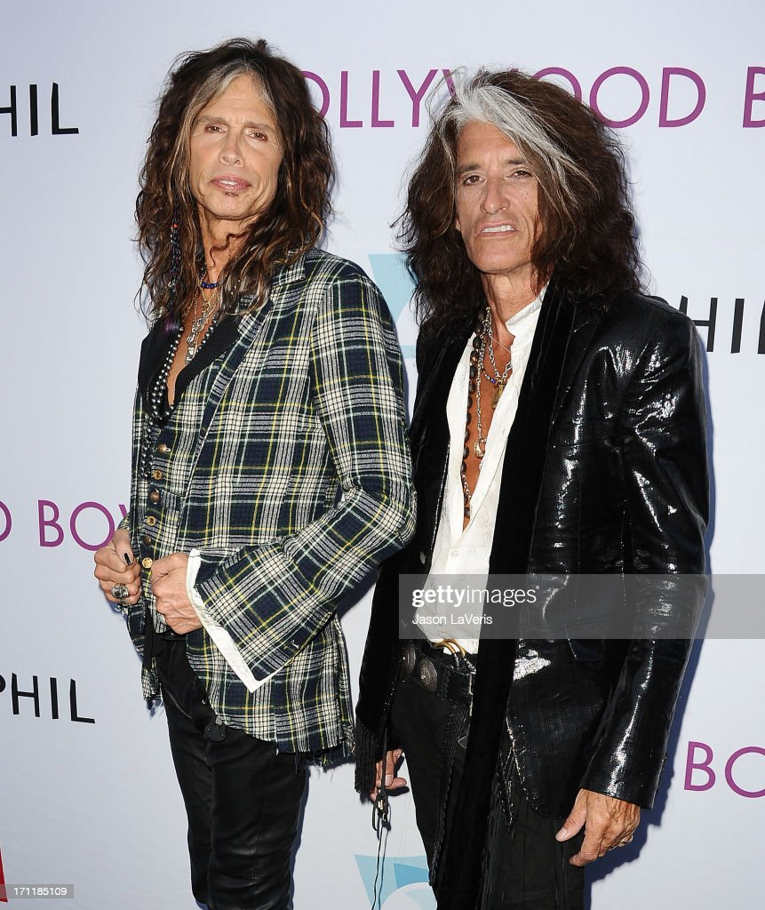 <a gi-track='captionPersonalityLinkClicked' href=/galleries/search?phrase=Steven+Tyler&family=editorial&specificpeople=202080 ng-click='$event.stopPropagation()'>Steven Tyler</a> and <a gi-track='captionPersonalityLinkClicked' href=/galleries/search?phrase=Joe+Perry+-+M%C3%BAsico&family=editorial&specificpeople=13600677 ng-click='$event.stopPropagation()'>Joe Perry</a> of Aerosmith attends the Hollywood Bowl opening night celebration at The Hollywood Bowl on June 22, 2013 in Los Angeles, California.