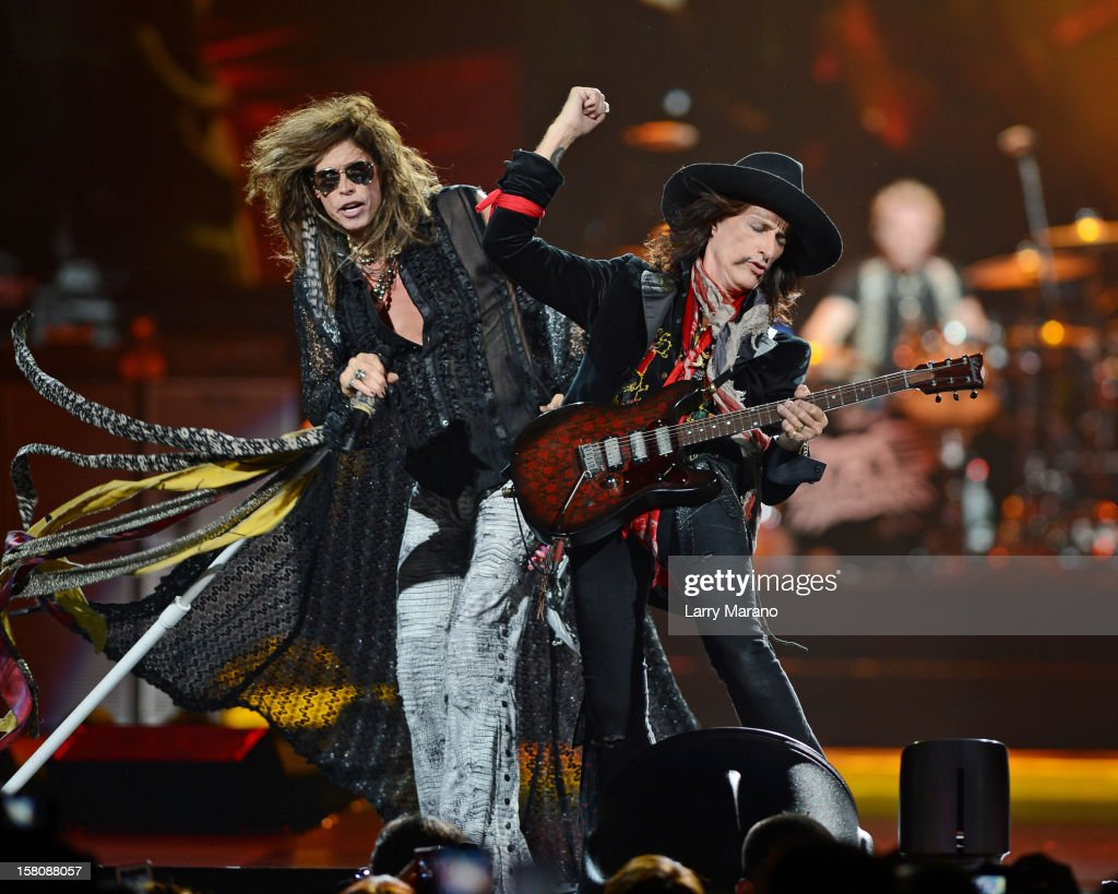 <a gi-track='captionPersonalityLinkClicked' href=/galleries/search?phrase=Steven+Tyler+-+Musician&family=editorial&specificpeople=202080 ng-click='$event.stopPropagation()'>Steven Tyler</a> and <a gi-track='captionPersonalityLinkClicked' href=/galleries/search?phrase=Joe+Perry+-+Musician&family=editorial&specificpeople=13600677 ng-click='$event.stopPropagation()'>Joe Perry</a> of Aerosmith perform at BB&T Center on December 9, 2012 in Sunrise, Florida.