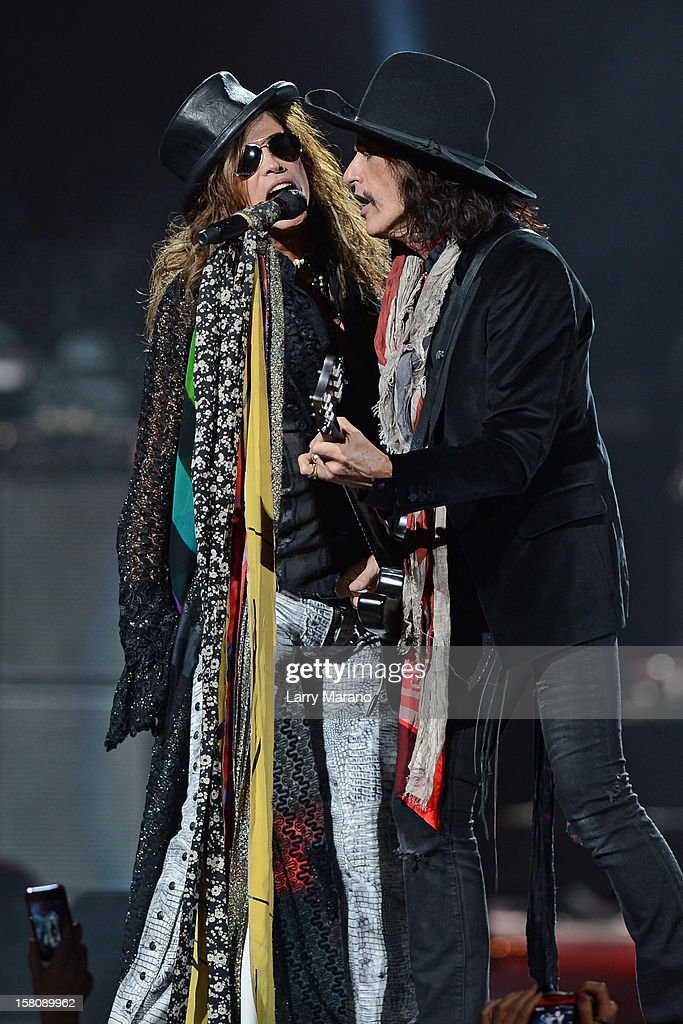 Steven Tyler and Joe Perry of Aerosmith perform at BB&T Center on December 9, 2012 in Sunrise, Florida.