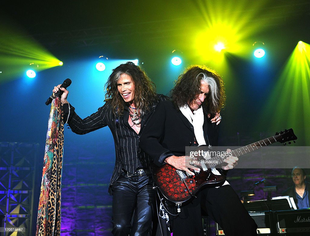 Steven Tyler and Joe Perry of Aerosmith perform at the Songwriters Hall of Fame 44th Annual Induction and Awards Dinner at the New York Marriott Marquis on June 13, 2013 in New York City.