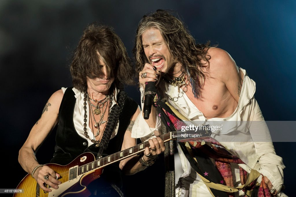 Steven Tyler and Joe Perry of Aerosmith perform on stage at Download Festival at Donnington Park on June 15 2014 in Donnington United Kingdom
