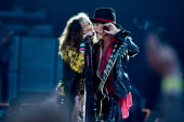 Steven Tyler and Joe Perry of Aerosmith performs on Day 1 of the Calling Festival at Clapham Common on June 28 2014 in London England