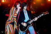 Steven Tyler and Joe Perry of American rock band Aerosmith perform on stage at Madison Square Garden on December 3rd 1975 in New York