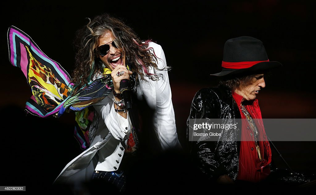 Steven Tyler and Joe Perry perform together as Aerosmith plays at Xfinity Center in Mansfield, Mass. on July 16, 2014.