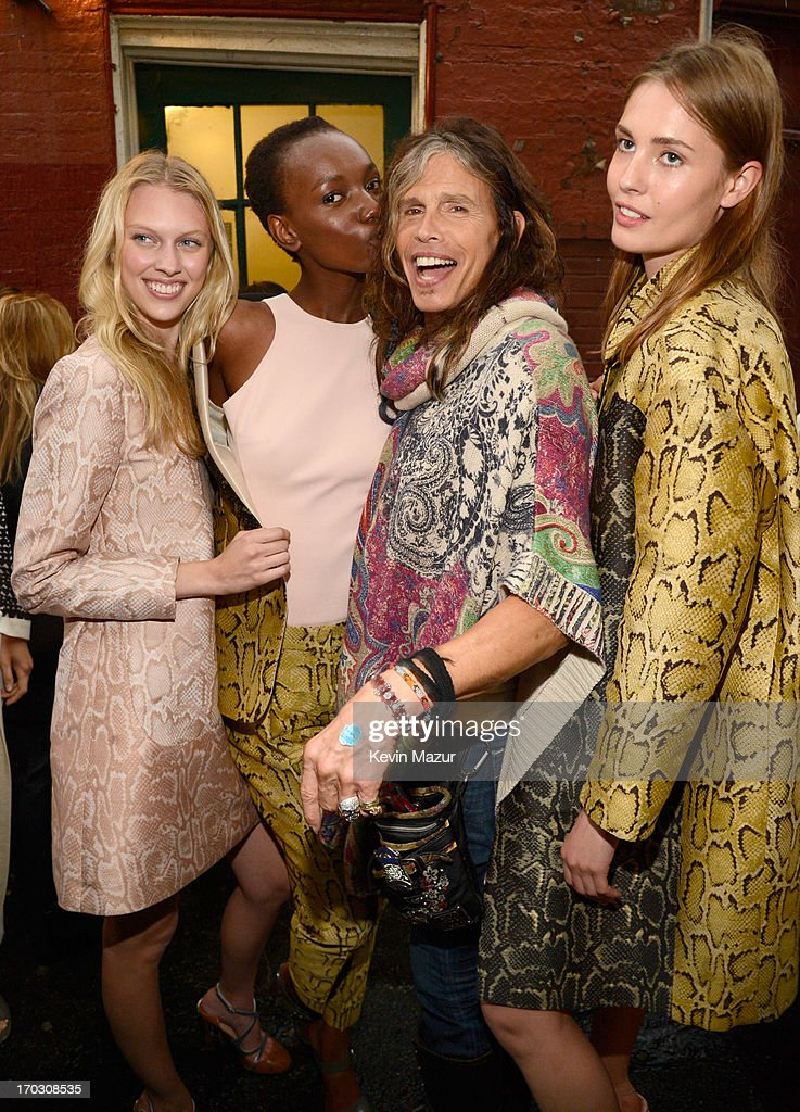 <a gi-track='captionPersonalityLinkClicked' href=/galleries/search?phrase=Steven+Tyler&family=editorial&specificpeople=202080 ng-click='$event.stopPropagation()'>Steven Tyler</a> (C) and models attend the Stella McCartney Spring 2014 Collection Presentation at West 10th Street on June 10, 2013 in New York City.