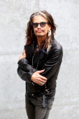 Steven Tyler attends the Emporio Armani show during Milan Menswear Fashion Week Spring Summer 2015 on June 23 2014 in Milan Italy